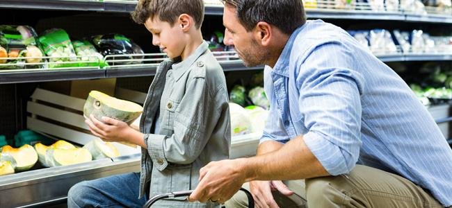 father and son shopping in a grocery store