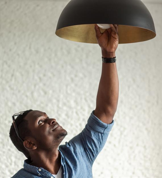 man changing a light bulb